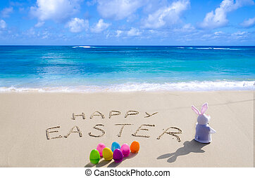"Sign ""Happy Easter"" with bunny on the beach"