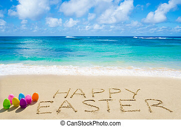 """Sign """"Happy Easter"""" with eggs on the beach"""