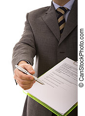Sign here - businessman hand pointing to the place in a ...