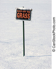 "sign in wrong season - ""Keep off Grass"" sign in the winter"