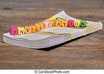 Sign INVESTIGATION and Wad of Bank Notes