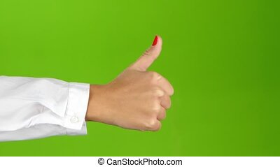 Sign language. Hand showing thumbs up on green screen...