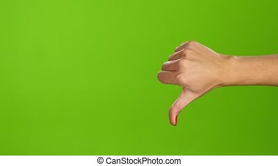 Sign language. Thumbs down female hand on green screen...