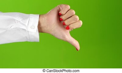 Sign language. Thumbs down woman hand on green screen background