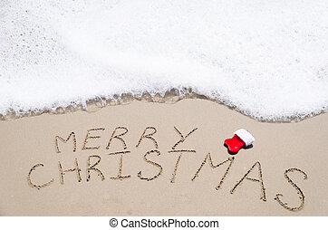 """Sign """"Merry Christmas"""" on the beach"""