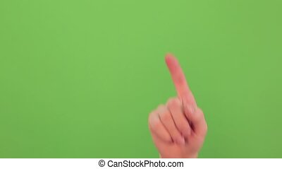 Sign NO with forefinger on green screen background. Real time video footage