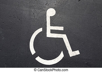 sign of a wheelchair at a parking lot
