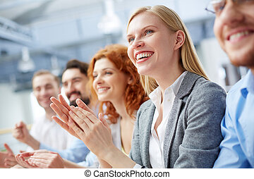 Sign of approval - Close-up of a businesswoman applauding at...