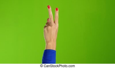 Sign of peace shows arm woman back of the hand - Sign of...