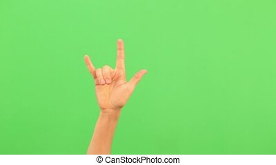 Sign of the horns. A rock on hand gesture. Heavy Metal. Chromakey. Green Screen. Isolated. Real time video footage.