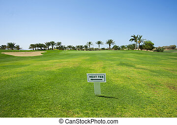 Sign on a golf course