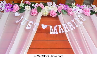 sign on a wooden background saying just married with lights