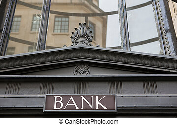 Sign On Exterior Of Bank Building
