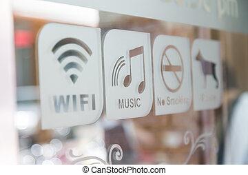 Sign on glass door (Free Wifi, Music, No smoke, Pet in)
