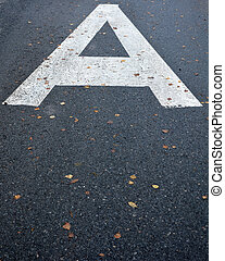 Sign on the road- letter A mean bus stop