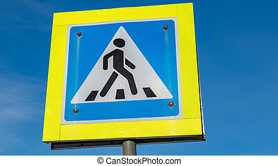 sign pedestrian crossing against the blue sky