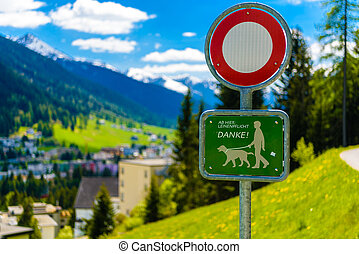 Sign plate with a dog in Alps mountains, Davos, Graubuenden, Switzerland