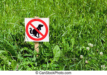 Sign prohibiting dogs shitting on the lawn