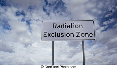 Highway road sign with the words Radiation Exclusion Zone written on it with a time-lapse clouds background.