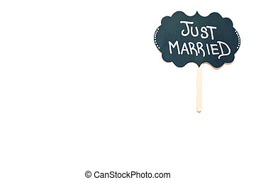 Sign reading just married on a white background