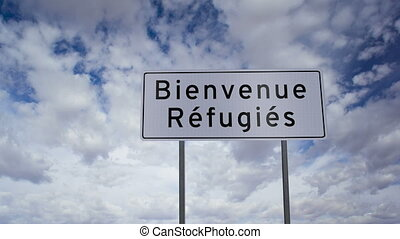 Sign Refugees Welcome French - Highway road sign with the...