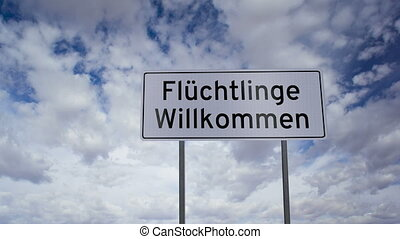 Sign Refugees Welcome German - Highway road sign with the...