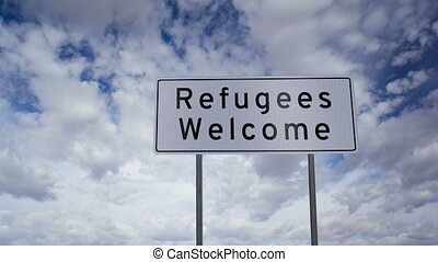 Sign Refugees Welcome Timelapse - Highway road sign with the...
