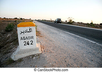 Sign road with distance to agadir