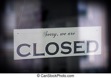 sign saying sorry we are closed
