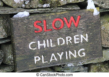 """Sign stating """"SLOW CHILDREN PLAYING"""