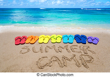 "Sign ""Summer camp"" and color flip flops on sandy beach"