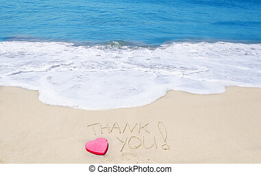"Sign ""Thank you"" on the beach"