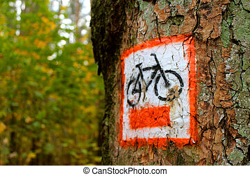 Information sign on the bike path, which is a tree in the Wielkopolski National Park.