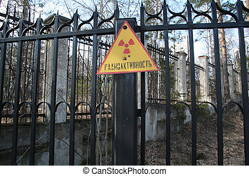 radiation - sign to radiation on railing