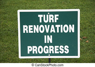 sign - TURF RENOVATION IN PROGRESS - green sign with white...