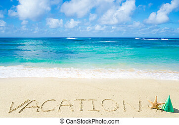 "Sign ""Vacation"" on the sandy beach"