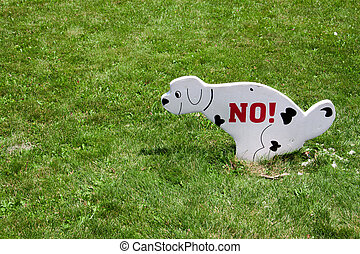 sign walking the dog on the lawn prohibited