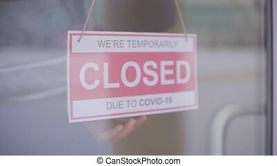 Sign we are open after covid. We Are Open Sign on the Glass Door.