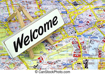 Black Sign WELCOME On White Board. London City Map On The Background