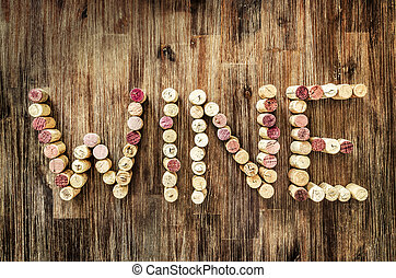 Sign wine made from corks on wooden vintage table
