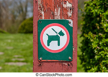 Sign with a dog in a leash