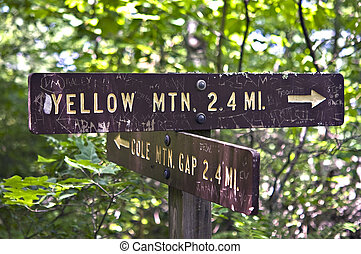 Sign with Graffiti on a Trail