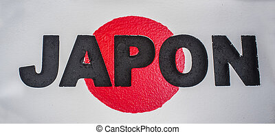 Sign with name of Japan and flag as background