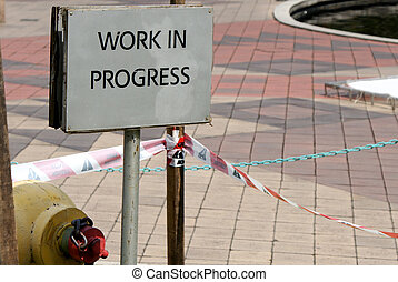 "sign ""work in progress"" at a construction site"