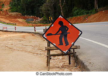 """sign """"Work in progress"""" on the road"""