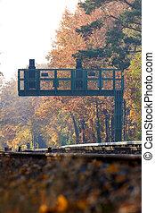 Signal at Railroad Tracks in Fall Portrait