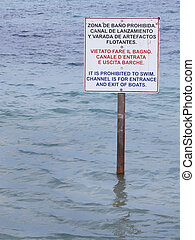 Signal post on the water. Prohibited to swim