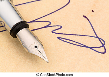 signature and pen - a fountain pen and a signature on yellow...
