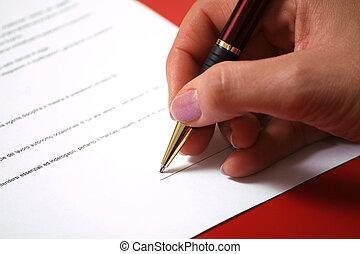 Signature - contract signature - closeup on woman hand