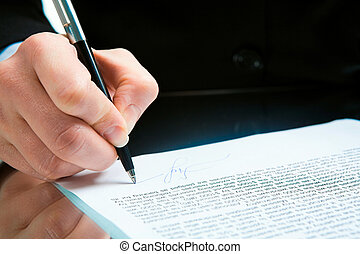 Signature - Conceptual image of human hand signing a...